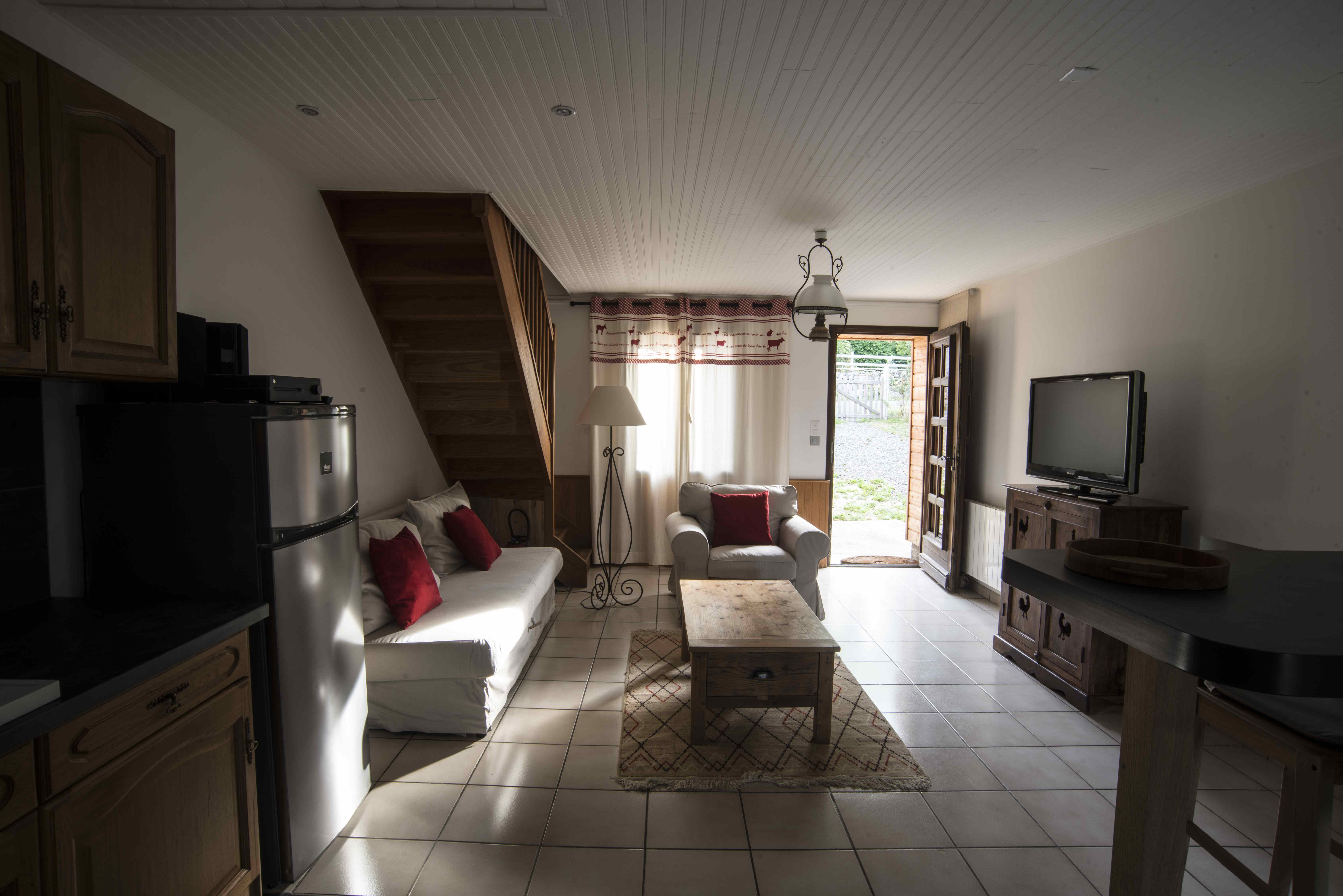 Cheminée, coin cuisine et petit salon indépendants de la Petite Maison