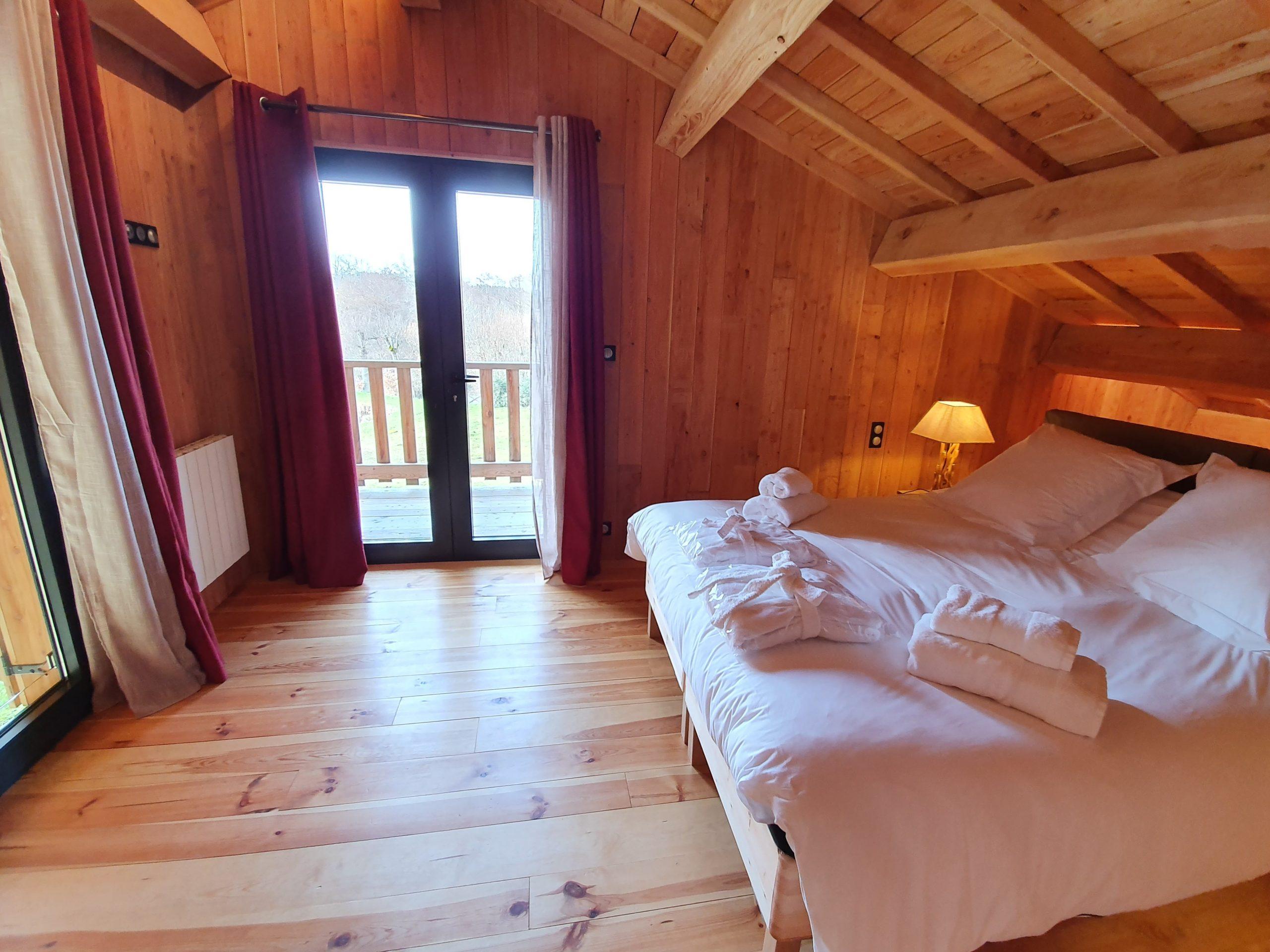 Chambre double avec balcon du chalet